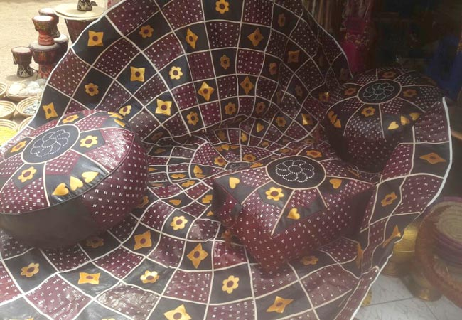 African Leather Carpet (55in) and 3 Leather Pouf Set