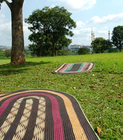 Instead of picnic blankets, think natural fiber African mats