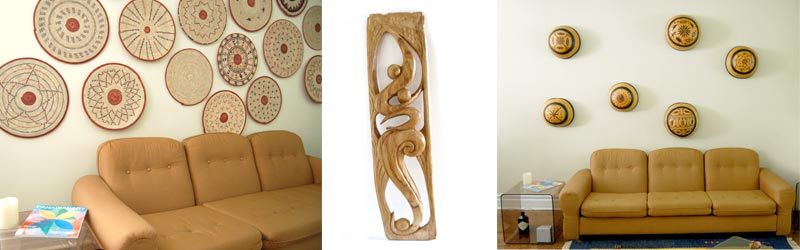 Examples of African wall decor: traditional flat baskets, contemporary wood sculpture, traditional calabash/gourds.