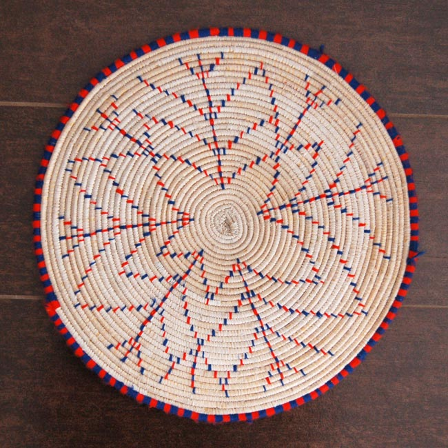 African flat basket with snowflake pattern (~12in)