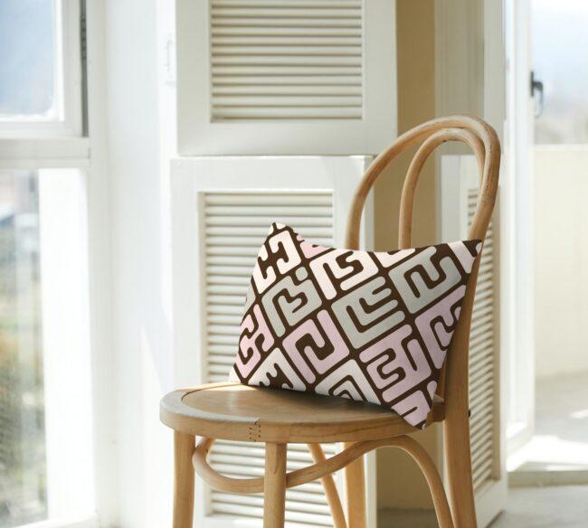 Kuba cloth inspired lumbar pillow – Earthtones with Pop of Pink