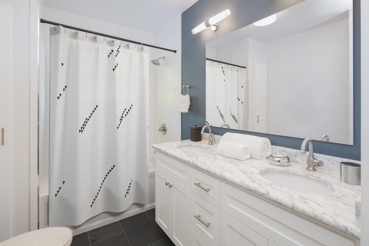 Black & White Shower Curtain with Minimalist Triangle Design (diagonal bias)